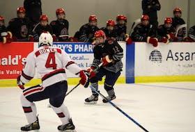 Halifax McDonalds forward Jacob Fletcher, right, breaks in on Kohltech Valley Wildcats defenceman Spencer Bower during Eastlink Nova Scotia Under-18 Major Hockey League Oct. 23 in Berwick.