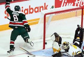 -Halifax Moosheads' Markus Vidicek jubilates after scoring against Cape Breton Screaming Eagles' goaltender Nicolas Ruccia five minutes into the first period Sunday.