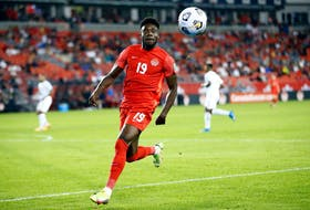 Alphonso Davies of Canada chases the ball during a 2022 World Cup qualifying match against Panama at BMO Field on Oct. 13, 2021, in Toronto.