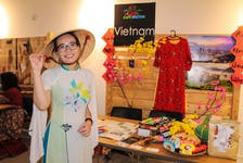 Second-year Cape Breton University student Ellyna Tran, who is from Vietnam, shares Vietnamese culture at the Hello Cape Breton: A World Gathering on an Island annual multicultural festival at the Convent in Sydney on Saturday. She is wearing an ao dai, a traditional Vietnamese garment. JESSICA SMITH/CAPE BRETON POST