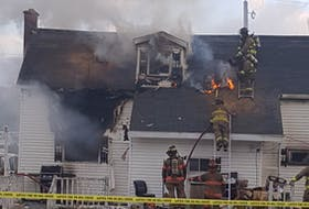Fire crews battle a house blaze on Maxie Street in Glace Bay on Sunday. One person was taken hospital with undisclosed injuires. CONTRIBUTED