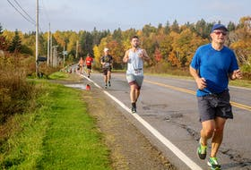 Race participants run down Point Edward Highway partway through the Point Edward Half Marathon that took place Saturday morning in Sydney. JESSICA SMITH/CAPE BRETON POST