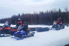 Michael Brophy of Churchill Falls and his family take every opportunity they can get to head out on their snowmobiles. He's been teaching his kids about proper use and safety for years. While he's in favour of some, one of the proposed changes to the Off-Road Vehicle Act is not sitting right with him. He says kids who outgrow their 125cc machines before the age of 13 — most will by a couple years earlier than that, he says — won't be able to ride. Left to right are his children Addison, Kason (on a 200cc engine snowmobile at age seven), Mackenzie and his wife Kim on the Northern Peninsula during Easter break in 2020.