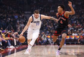 Luka Doncic #77 of the Dallas Mavericks drives against Scottie Barnes #4 of the Toronto Raptors during their NBA game at Scotiabank Arena on October 23.
