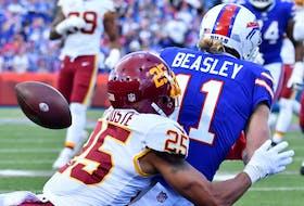Washington Football Team cornerback Benjamin St-Juste breaks up a pass intended for Buffalo Bills wide receiver Cole Beasley.