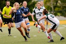The St. Francis Xavier X-Women defeated the UPEI Panthers 35-15 in the AUS rugby semifinal Saturday in Antigonish. - BRYAN KENNEDY