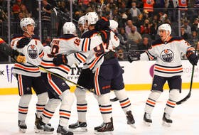 The Edmonton Oilers celebrate a first-period power-play goal by Zach Hyman (18) against the Vegas Golden Knights at T-Mobile Arena on Oct. 22, 2021, in Las Vegas.