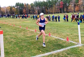 Gorsebrook Junior High School's Alexander Bouchard crosses the finishes line to win the intermediate boys' race at the NSSAF cross-country championship at Osprey Ridge Golf Course in Bridgewater on Monday.
