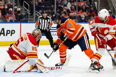Edmonton Oilers' Zach Hyman (18) shoots at Calgary Flames goaltender Jacob Markstrom (25) at Rogers Place in Edmonton on Monday, Oct. 4, 2021.