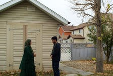 Azatullah and Mastora, both Afghan refugees, arrived in Canada with 11 other relatives in August. They stand in the backyard of their new home in Calgary's north-east. October 13, 2021 (Bryony Lau photo)