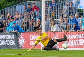 Kieran Baskett slides to make a stop during the HFX Wanderers' Canadian Championship preliminary match against AS Blainville on Aug. 17, The match marked the professional debut of the keeper from Halifax. - TREVOR MacMILLAN / CANADIAN PREMIER LEAGUE