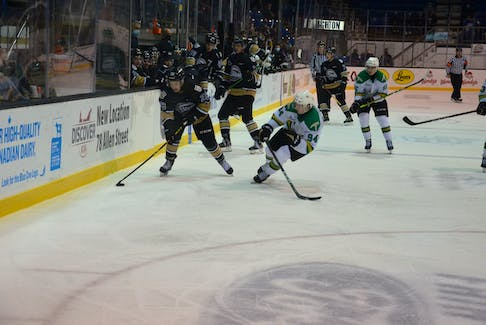 Charlottetown Islanders forward Matis Ouellet carries the puck into the offensive zone while under pressure from the Val-d'Or Foreurs' Nathan Bolduc, 94. Charlottetown outscored Val-d'Or 7-5 in the Quebec Major Junior Hockey League game played at the Eastlink Centre on Oct. 24.