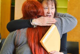 In this file photo, Ann McPhee from the Ann Terry Society in Sydney hugs Jenna Wall after Wall completed the society's women's transition to employment program in May 2019. McPhee was one of six people presented with a Women of Substance award on Oct. 18. CAPE BRETON POST