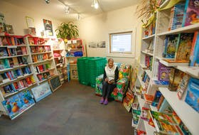 FOR DEMONT STORY: Liz Crocker looks at a book inside the children's book/toy store Woozles, that she and her late husband opened 43 years ago, in Halifax Monday October 25, 2021. Today the store will be closing and moving from its longtime home, to Shirley street.  TIM KROCHAK PHOTO