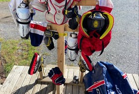 A t-shaped rack to dry hockey equipment after it is washed, or to help air it out, can prevent odour build up. Contributed photo