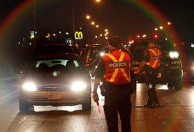 Police officers stop drivers near Windsor Raceway on August 14, 2010 during a RIDE program in Windsor, Ont.