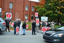 About 20 'Stop Sandy Point Wind' effort supporters rally outside the Shelburne Municipal Building on Oct. 20. The group had asked Shelburne Municipal Council to revoke a letter of support in principle they had written for the proponents of a proposed wind farm in Sandy Point. Council decided the letter will stand. KATHY JOHNSON