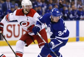 Maple Leafs' Auston Matthews with Carolina Hurricanes' Jordan Staal at the Air Canada Centre in Toronto on October 22, 2017.
