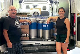 Richard Doucette and Melanie Sweeney (co-owner of Tusket Falls Brewing Co.) prepare to stock up the new Tusket Falls Beer Project in Halifax for its opening last month.