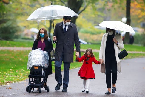 MP Sean Fraser arrives with his family to attend the swearing-in ceremony of Justin Trudeau new cabinet at Rideau Hall in Ottawa on Tuesday, Oct. 26, 2021.