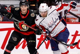 Ottawa Senators'  Alex Formenton (10) battles with Washington Capitals right winger Daniel Sprong at the Canadian Tire Centre on Monday night.