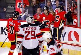The Calgary Flames' Derek Ryan scores on New Jersey Devils goaltender Mackenzie Blackwood at the Scotiabank Saddledome in Calgary on Nov. 7, 2019.