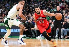 Raptors guard Fred VanVleet (23) drives to the basket against Boston Celtics forward Jayson Tatum.
