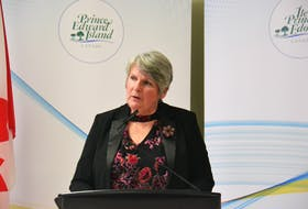 Finance Minister Darlene Compton takes questions from reporters before presenting the 2021 capital budget in the legislature. The budget includes $212.1 million in spending in 2022-2023 and almost $840.4 million in spending over five years.