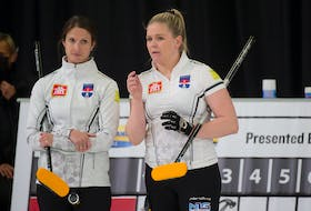 Skip Suzanne Birt left, and Marie Christianson discuss a shot during Draw 1 at the Home Hardware Canadian Curling Pre-Trials at the Queens Place Emera Centre in Liverpool on Monday. Michael Burns/ Curling Canada