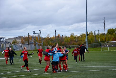 The Acadia Axewomen celebrate after winning the Atlantic University Field Hockey League (AUFHL) championship in Charlottetown on Oct. 24. The Axewomen defeated the host UPEI Panthers 2-1 in the championship game. Acadia last won an Atlantic university field hockey championship in 1957.