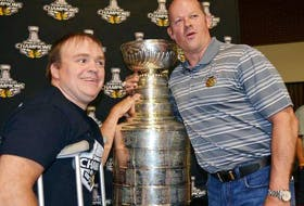 Al MacIsaac, right, poses with a fan during a visit to Antigonish in 2015 after the Chicago Blackhawks won the Stanley Cup.