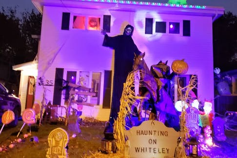 David and Chantelle Keen moved to Whiteley Drive in Mount Pearl six months ago and brought their Halloween decorations with them. The family encouraged people to stop by, see the house, and leave a food donation for local food pantries.