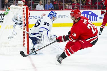 Maple Leafs goaltender Jack Campbell stops a shot by Carolina Hurricanes' Sebastian Aho during the third period at PNC Arena on Monday, Oct. 25, 2021.