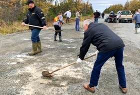 A group of 25 volunteers took to areas of the highway between Colinet and Markland on Tuesday, Oct. 26, to fill in some of the potholes that plague the road.
