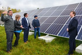 Equilibrium Engineering principal Jeremy Lutes, left, explains a solar array installed as part of a deep energy retrofit at Windsor Elms Village. He was with, from second left, the long-term care facility's CAO Susan MacDougall; Kings-Hants MP Kody Blois, West Hants Regional Municipality Mayor Abraham Zebian and EfficiencyOne president and CEO Stephen MacDonald. KIRK STARRATT