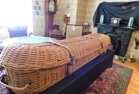 An antique wicker cooling casket, typically kept in the most prestigious Victorian homes to store a dead body while preparing for the funeral, is displayed at Beaconsfield Historic House for Halloween.