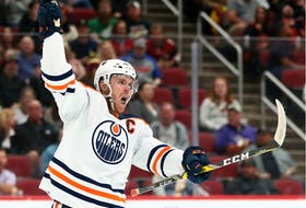 Edmonton Oilers center Connor McDavid (97) celebrates his goal against the Arizona Coyotes at Gila River Arena on Oct 21, 2021.