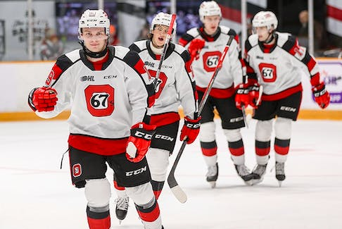 Jack Beck celebrates his first of two goals during a recent Ottawa 67's game. The Flames prospect worked hard to hone his shot during quarantine.