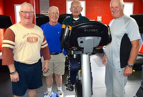 Camey Darroch, centre, 89, of New Waterford, works out on an exercise bike at Wil-Tones Family Fitness on Smith Street in New Waterford surrounded by his gym buddies of more than 20 years including, from the left, Paul (Red) Cormier, 66, Duncan (Buller) MacKenzie, 78, and Joe Aucoin, 75. Darroch says he loves the gym for not only health reasons but also the camaraderie you find there. Sharon Montgomery-Dupe/Cape Breton Post