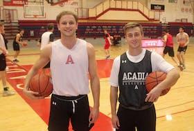 Acadia Axemen Rowan Power, left, and Jack Tilley are excited to begin the Atlantic University Sport basketball season. Jason Malloy