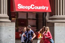 Pedestrians walk past a Sleep Country Canada location in Toronto on June 19, 2018.