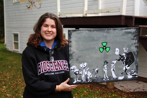 Alicia Fleming holds character design art drawn by her business partner, Joseph-Patrick Dalton. Fleming is writing on a 10-part animated series which she plans to pitch to a streaming service.