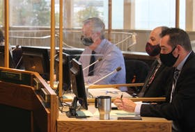 From left, Deputy Mayor Earlene MacMullin and councillors Steve Gillespie, Eldon MacDonald and Glenn Paruch listen to a solid waste management presentation inside city hall council chambers on Tuesday, their first full council appearance since the pandemic began in March 2020. IAN NATHANSON • CAPE BRETON POST