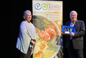 Former Saltscapes Magazine co-owner Linda Gourlay presented Hanspeter Stutz with the Gary MacDonald Culinary Ambassador Award. Wendy Elliott