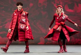 Paul Poirier and Piper Gilles model lululemon athletica's new Team Canada uniforms for the Beijing 2022 Winter Olympics in Toronto on October 26, 2021.