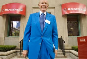 Ted Rogers poses for a photograph outside a Rogers store following the company's annual general meeting in Toronto, in 2007.