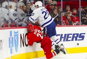 Leafs winger Nick Ritchie drills Brett Pesce of the Hurricanes with a heavy check on Monday night. A little more of this attitude likely wouldn't hurt the team's bid to shake its early-season doldrums. J