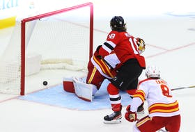 New Jersey Devils center Dawson Mercer (18) scores a goal on Calgary Flames goaltender Dan Vladar (80) during the third period at Prudential Center, Tuesday, Oct. 26, 2021. (USA TODAY Sports)
