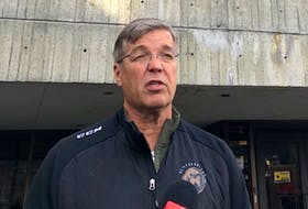 Newfoundland Growlers principal owner Dean MacDonald speaks to reporters outside St. John's City Hall Wednesday shortly after an announcement that the Growlers were being suspended from using Mary Brown's Centre pending an investigation of disrespectful workplace conduct made by employees of St. John's Sports and Entertainment, which runs the facility, against Growlers employees. — Joe Gibbons/The Telegram