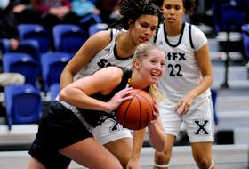 Hannah Chadwick of Dalhousie is guarded by Tyra Atherley of St. Francis Xavier as her sister Kira Atherley looks on during an AUS women's basketball pre-season game Oct. 9 in Antigonish. - BRYAN KENNEDY / ST. F.X. ATHLETICS